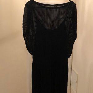 Black pleated dress with slip.